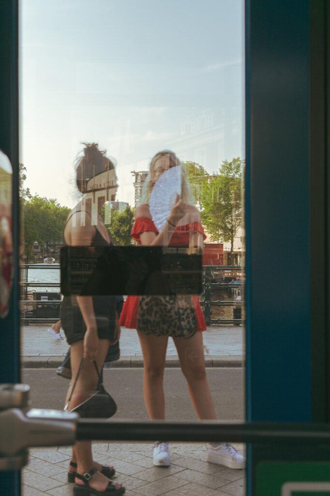 Dutch girls with a hand fan
