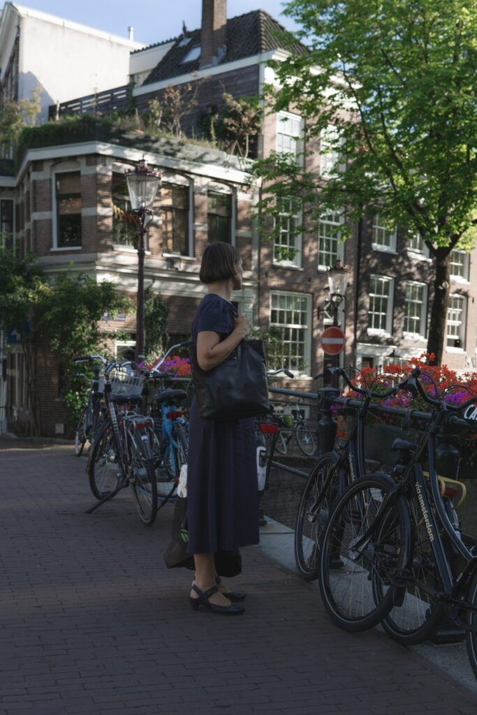 Woman looking over a canal in Amsterdam