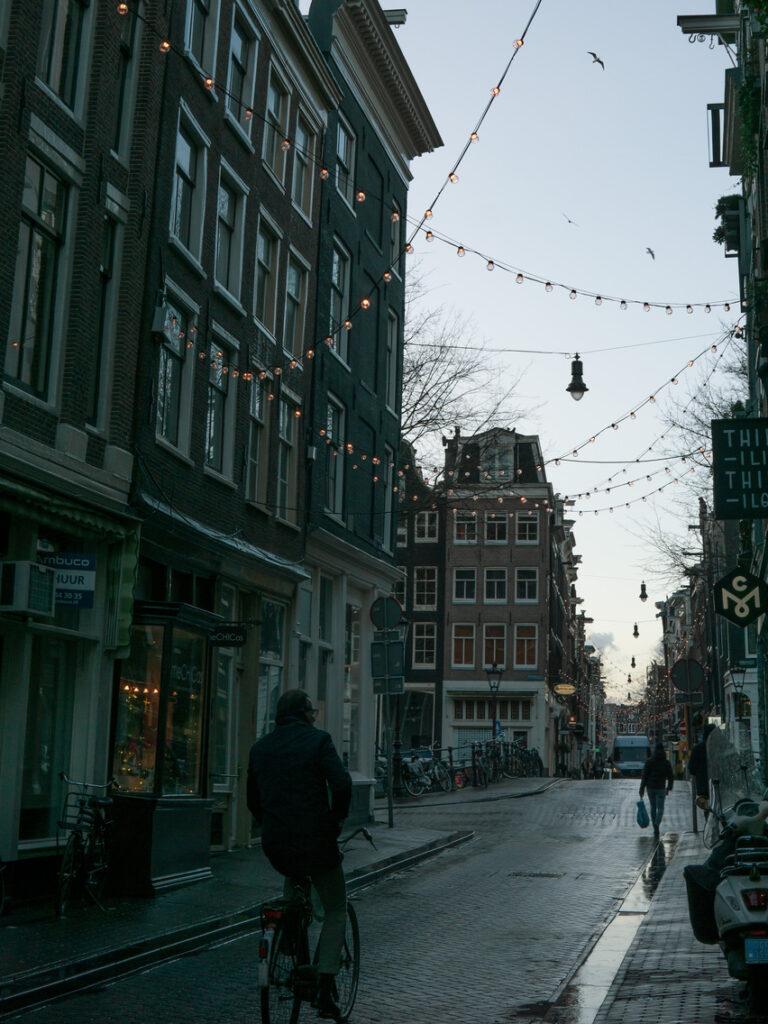 biking through Jordaan Amsterdam
