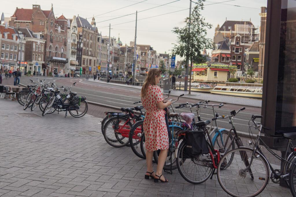 a young woman in a feminine summer dress center Amsterdam