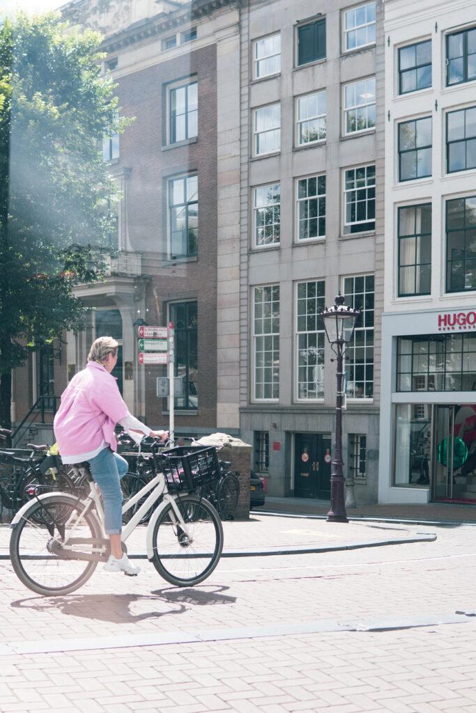 pink jacket, Hugo Amsterdam, biking on Leidsestraat