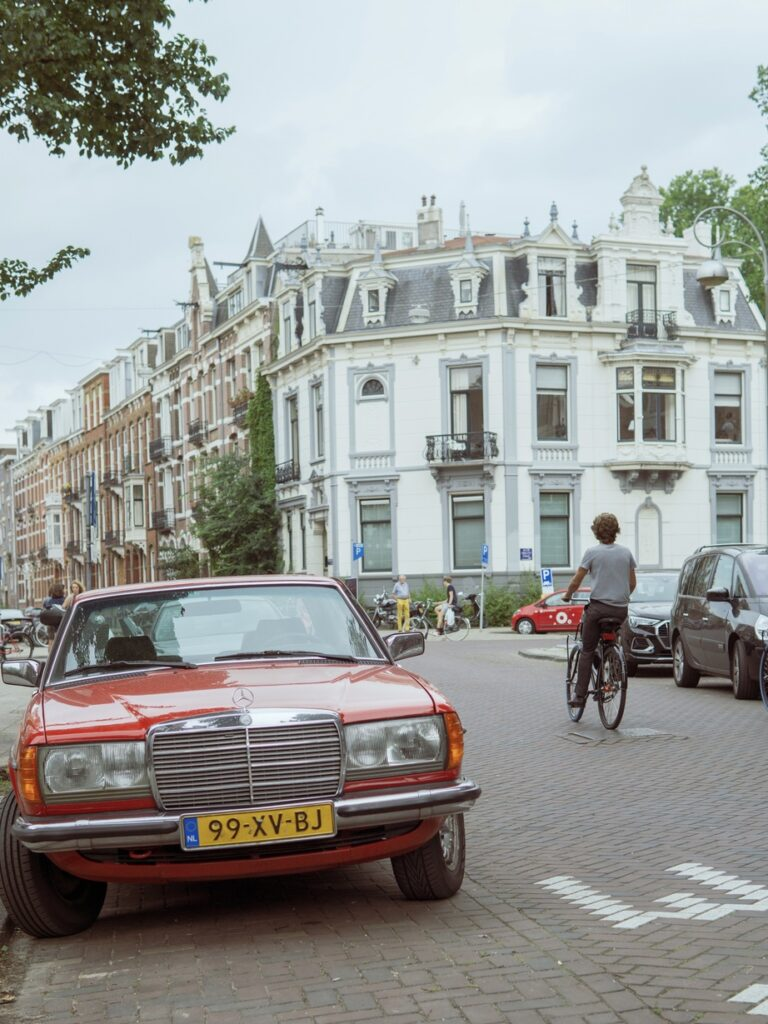 red classic Mercedes in the center of Amsterdam