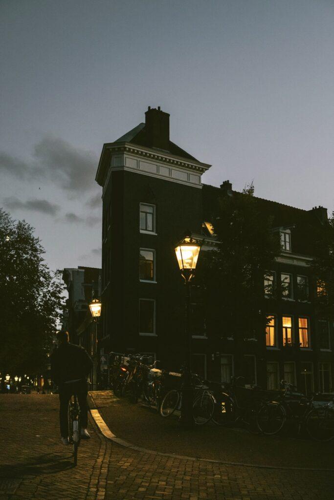 rushing through dusk in the center of Amsterdam