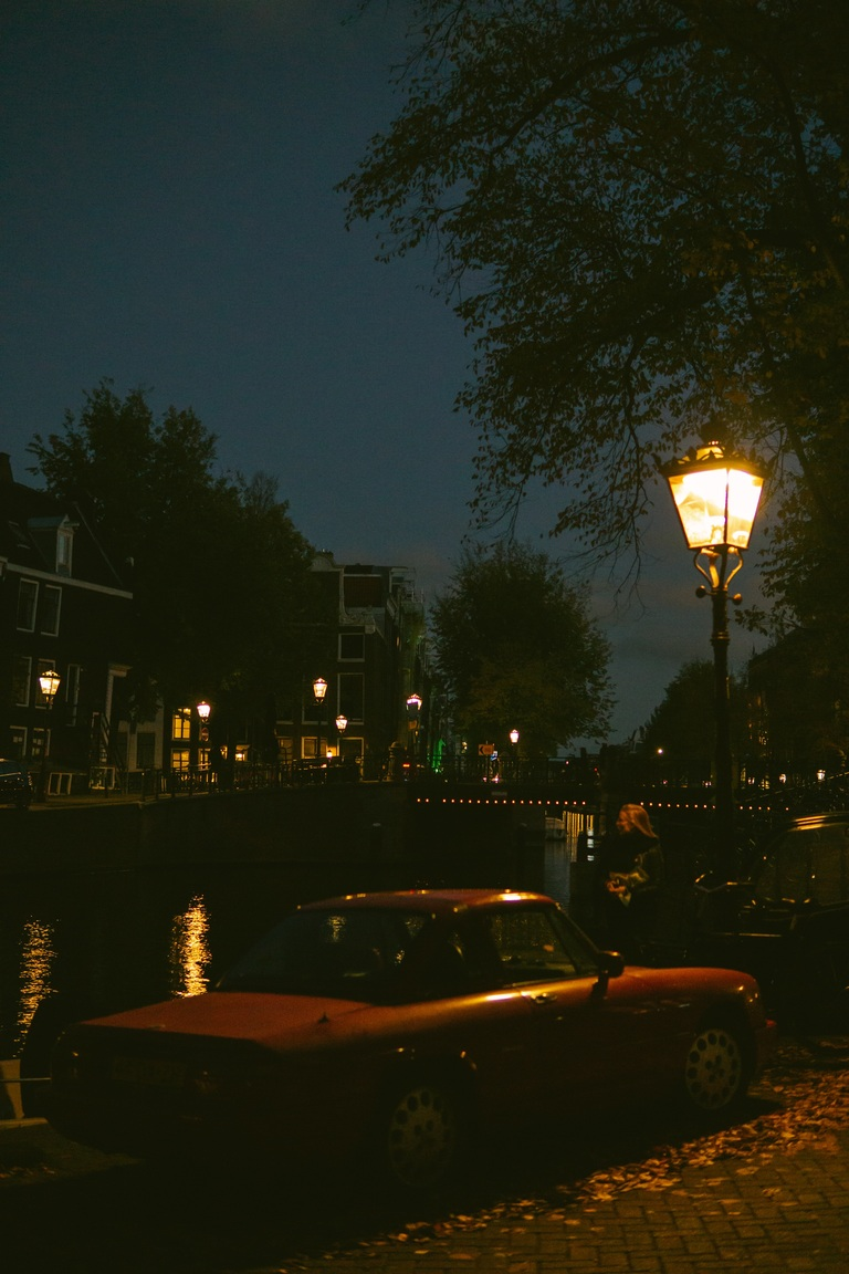 vintage car under lamppost, Amsterdam canal