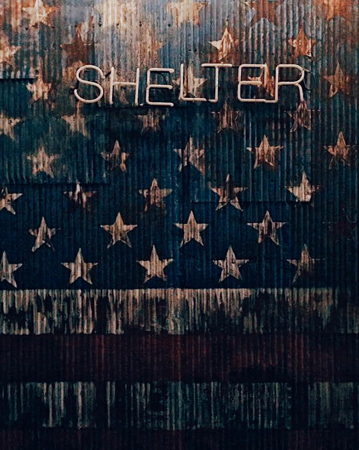 American vintage looking flag, with the word Shelter on it