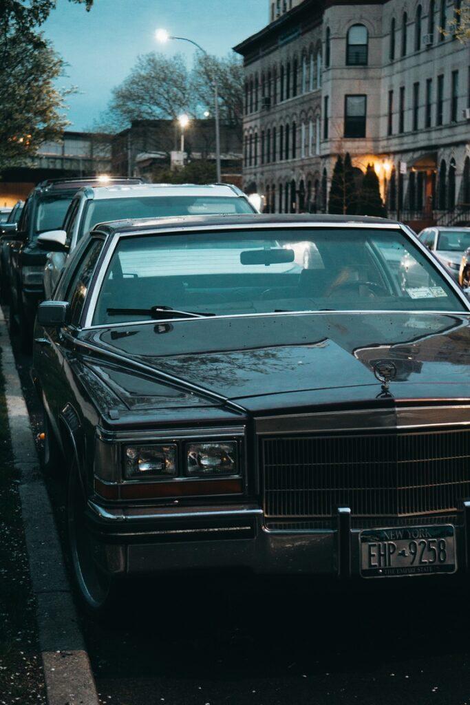 Cadillac lit by Brooklyn twilight