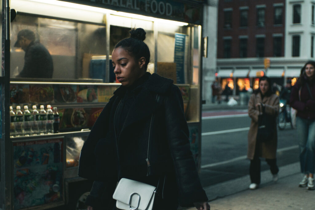 female walking in SoHo
