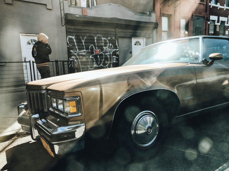 brown Cadillac and rays of light in Brooklyn
