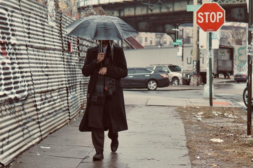 hasid under an umbrella