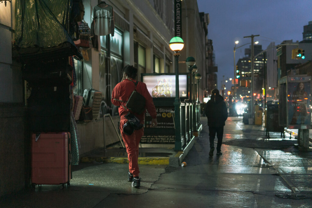 a guy wearing a red suit, Canal street
