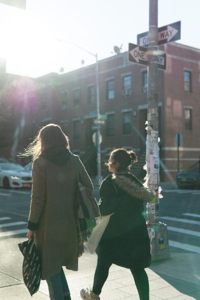 women walking with rays of sunshine, Williamsburg