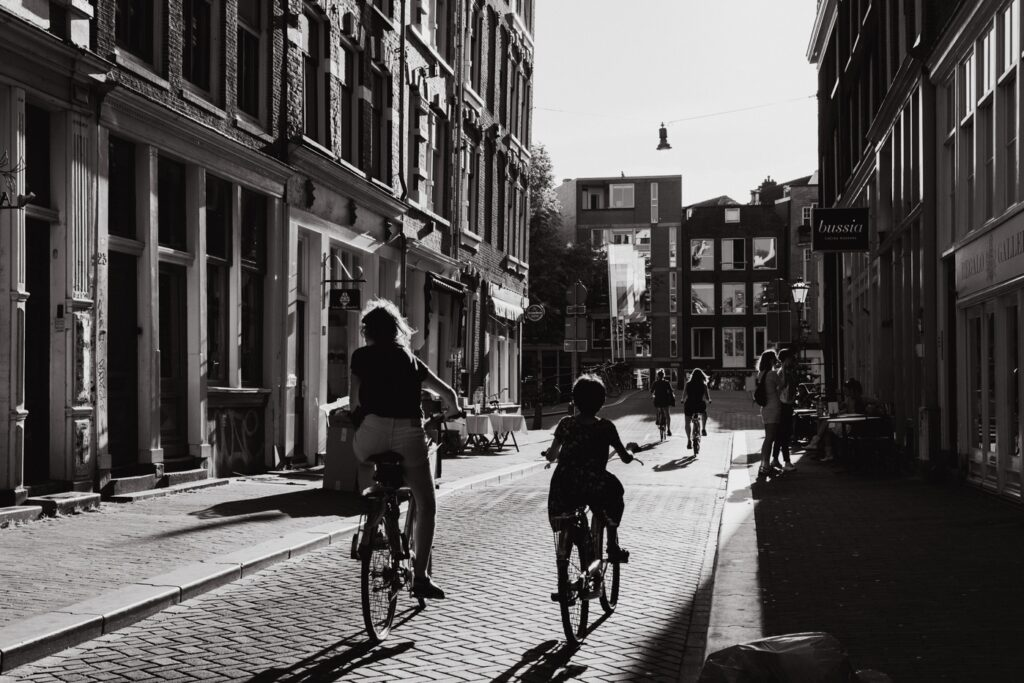 mom and daughter on bikes in Amsterdam